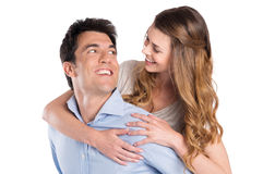 扛在肩上妇女的年轻人 图库摄影