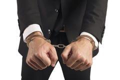 扣上手铐的商人 免版税库存图片