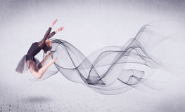 执行与抽象漩涡的现代跳芭蕾舞者 免版税库存照片