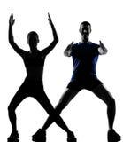 执行人妇女锻炼的夫妇 免版税库存照片