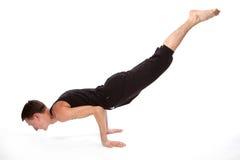 执行人瑜伽年轻人 免版税图库摄影