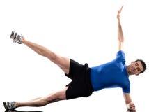 执行健身人姿势锻炼的abdominals 免版税库存照片