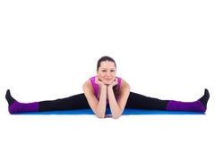 执行在体操方面的健康少妇 免版税图库摄影