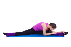 执行在体操方面的健康少妇 免版税库存照片