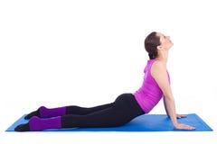 执行在体操方面的健康少妇 库存图片