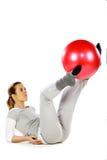 执行女孩的球红色她的行程 库存图片