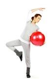 执行女孩红色的球 免版税库存图片