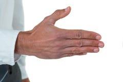 执行委员的中间部分他的提供的握手的手 图库摄影