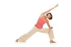 执行姿势副女子瑜伽年轻人的角度 免版税图库摄影