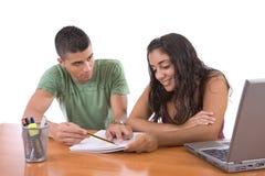 执行家庭作业十几岁 免版税库存照片