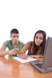 执行家庭作业十几岁 免版税库存图片