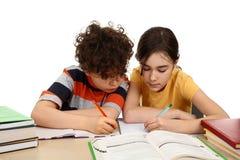 执行家庭作业孩子 图库摄影