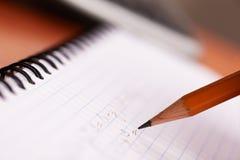 执行家庭作业算术 图库摄影