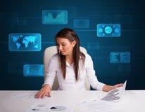 执行文书工作有数字式背景的女实业家 免版税库存图片