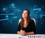 执行文书工作有未来派背景的女实业家 免版税库存图片