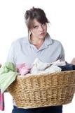 执行查出的洗衣店生气妇女 免版税库存图片