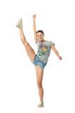 执行滑稽的女孩体操 免版税库存照片