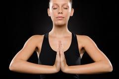执行瑜伽的新白种人妇女纵向  库存照片