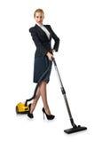 执行真空清洁的女实业家 免版税库存照片