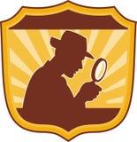 扩大化侦探的玻璃 免版税库存图片