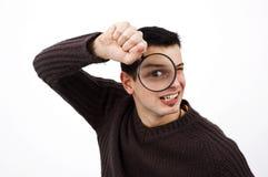 扩大化玻璃的人 免版税库存图片