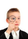 扩大化玻璃的孩子 图库摄影