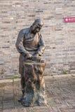 扬州东管国街街道雕塑----切开菜人 图库摄影