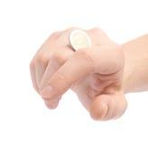 扭转与指关节的硬币 免版税库存照片