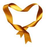从扭转的丝绸丝带的黄色心脏形状框架 图库摄影