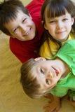 扮小丑的家庭孩子三 免版税库存照片