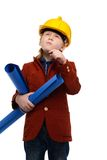 扮演工程师角色的小男孩 免版税库存照片