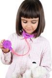 扮演医生的小女孩 免版税库存照片