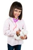 扮演医生的小愉快的女孩 免版税库存照片