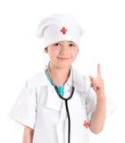 扮演医生的微笑的小女孩 免版税库存照片
