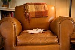 扶手椅子书皮革 库存照片