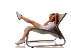 扶手椅子大女孩一点 免版税库存图片