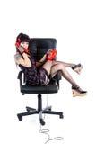扶手椅子女孩现代办公室pinup 免版税库存图片