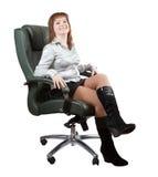 扶手椅子愉快的豪华办公室坐的妇女 库存照片