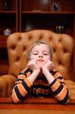 扶手椅子男孩豪华办公室坐 库存照片