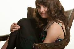 扶手椅子的女孩 免版税库存照片