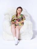 扶手椅子的孕妇 图库摄影