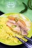 批评在菠萝板条的嫩煎的鱼用蒸丸子 免版税库存图片