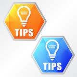 技巧和电灯泡标志,两个颜色六角形网象 库存图片