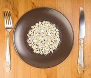 技术抽象想法作为食物,在板材的leds的 免版税库存照片