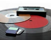 技术的变动从留声机圆盘对SD卡片 免版税库存照片