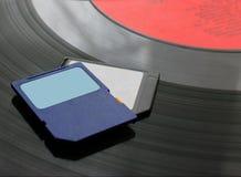 技术的变动从留声机圆盘对SD卡片 免版税库存图片