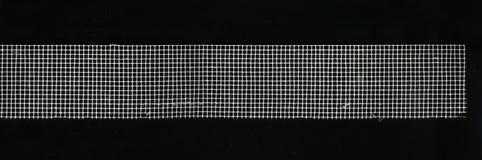 技术织品-绘与方形的细胞的栅格 免版税库存照片