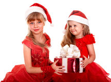 把儿童子句礼品组帽子红色圣诞老人& 免版税库存图片