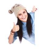 把她的手指指向的妇女空白广告牌 免版税库存照片