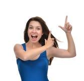 把手手指指向的年轻深色的妇女画象角落 图库摄影